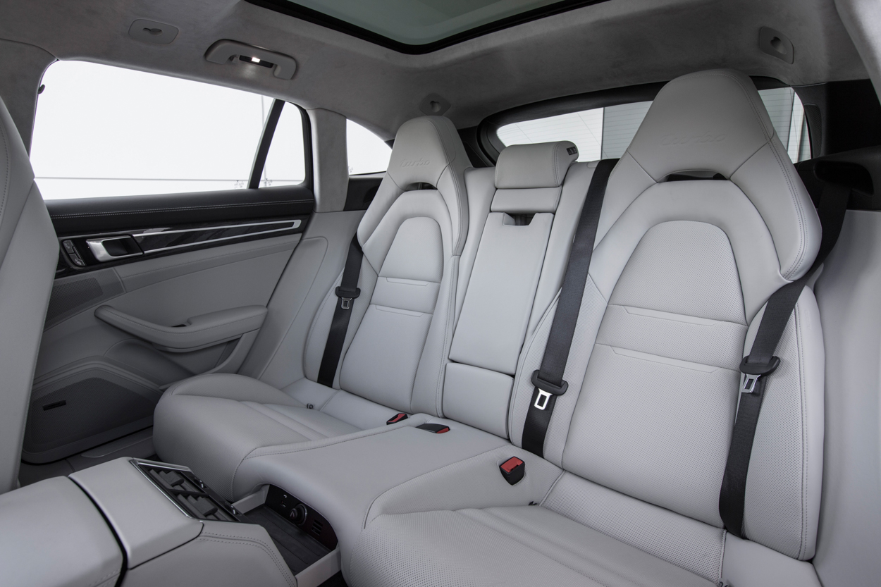 Above Panamera Sport Turismo Gets A Middle Seat In The Back Standard What Porsche Calls 4 1 Seating Buyers May Opt For Traditional Four Seats If